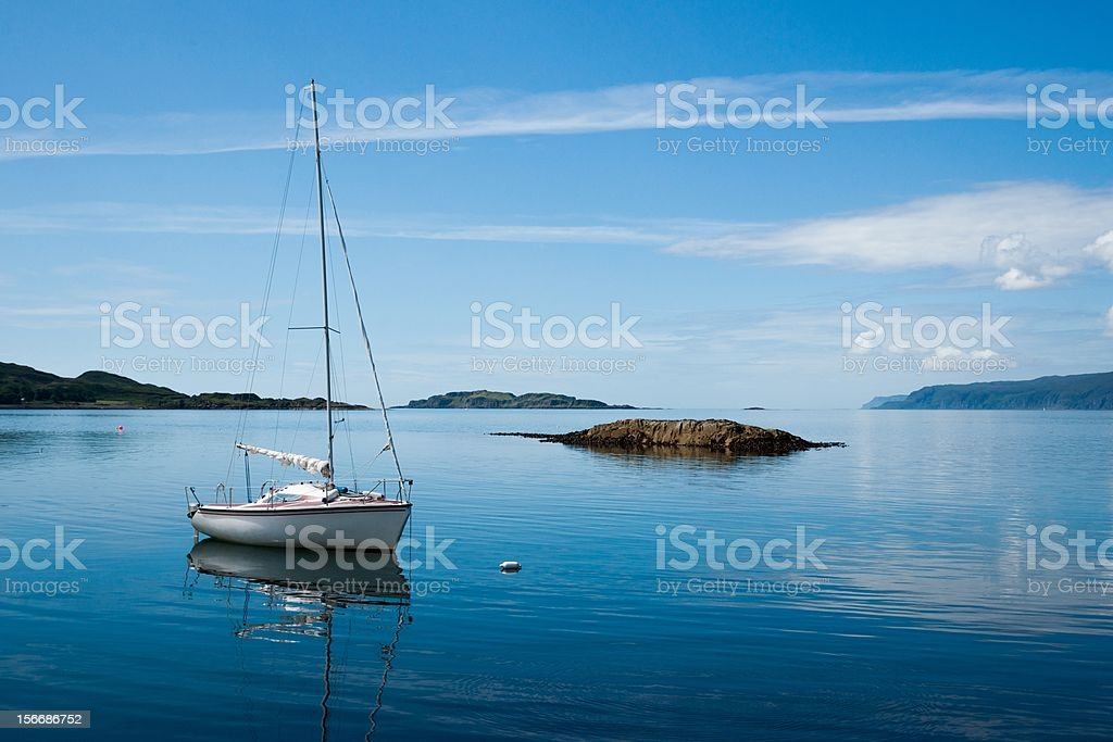 Small boat at anchor on sunny day in Scottish Islands royalty-free stock photo