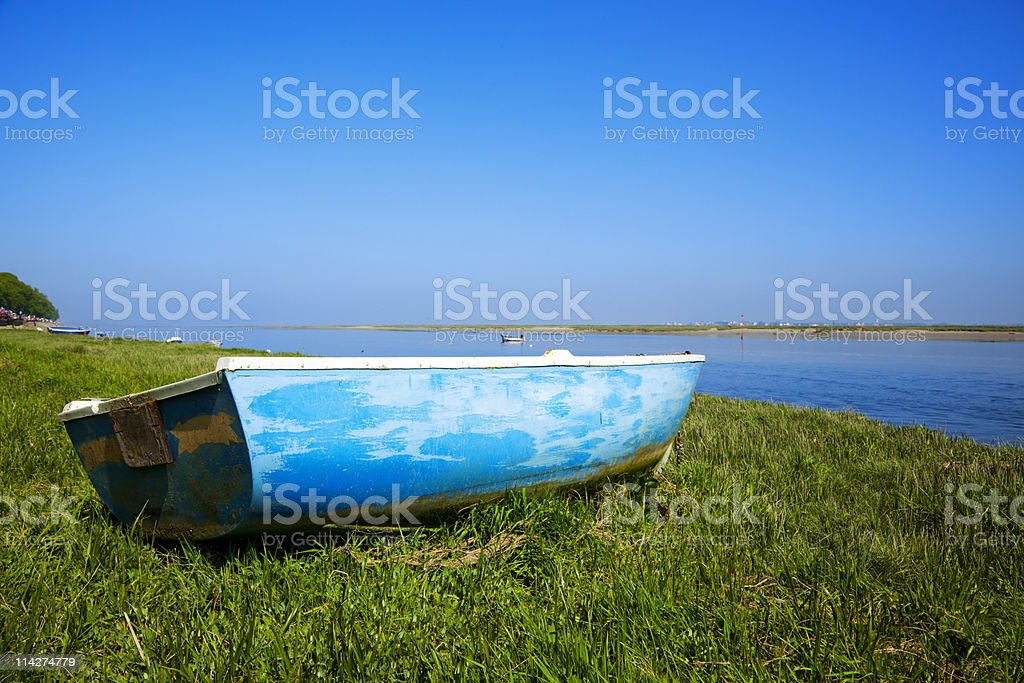 small boat at the shore of river Somme, Normandy, France royalty-free stock photo