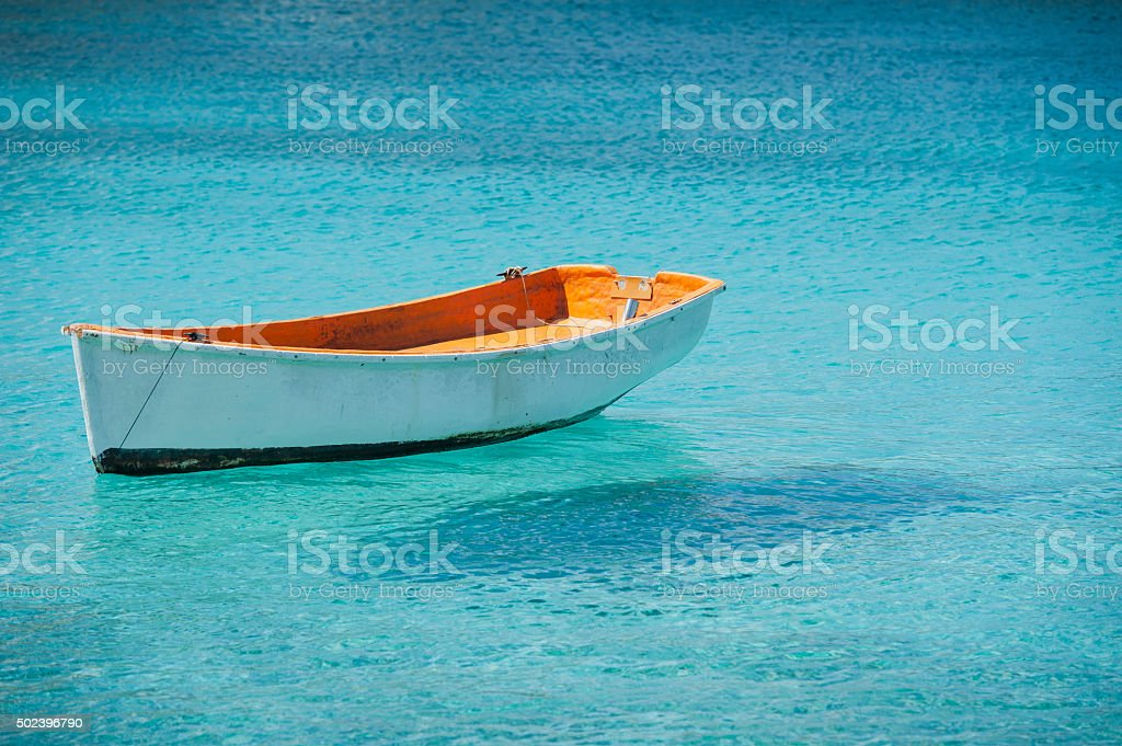 small boat floating on the caribean sea stock photo