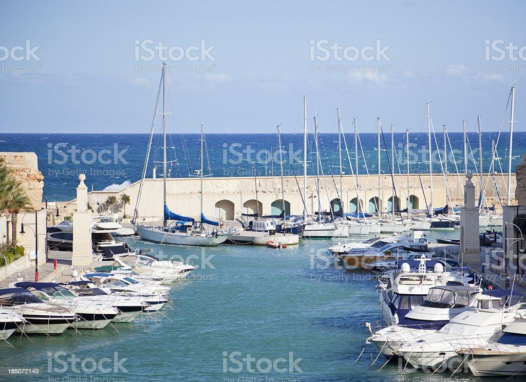 Small boat harbor with Mediterranean view. St Julian's. Malta. stock photo
