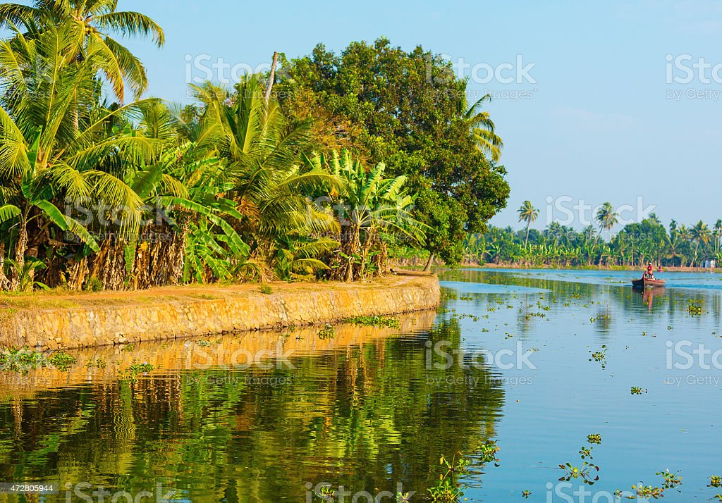 Small boat in a canal of Kerala stock photo