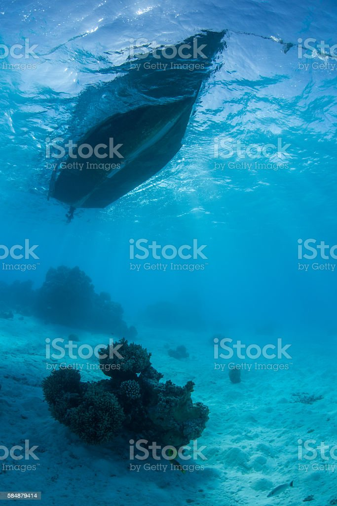 Small Boat in Blue Lagoon stock photo