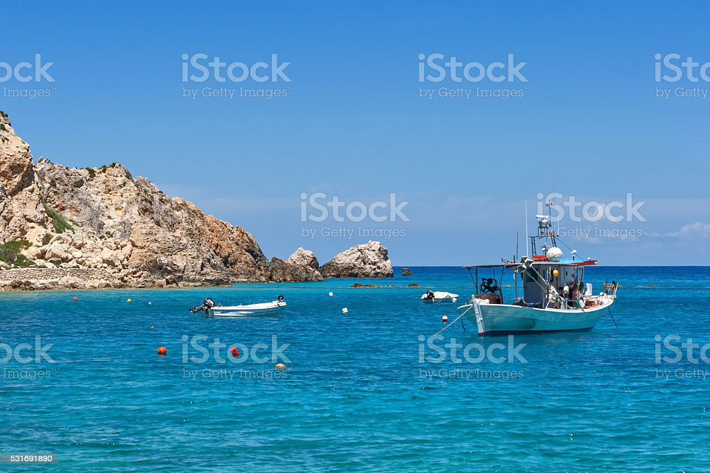 Small Boat in the Blue waters of Ionian sea, Lefkada stock photo