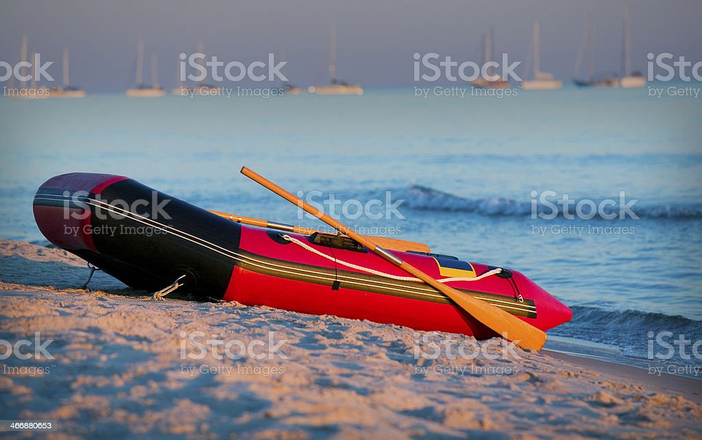 Small boat on beach.GN stock photo