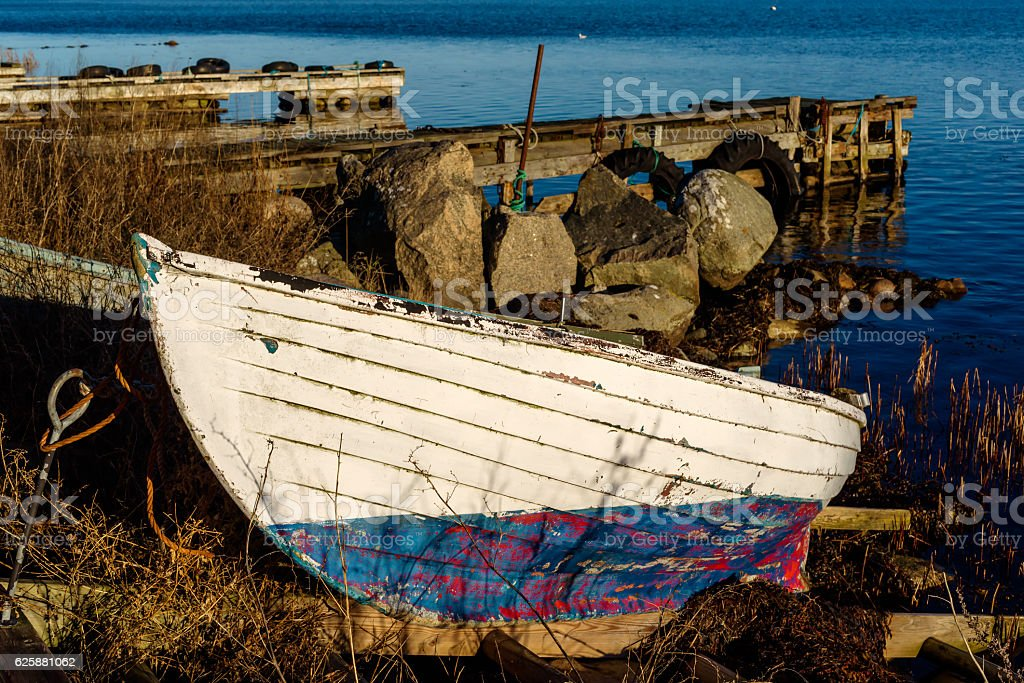 Small boat on land stock photo