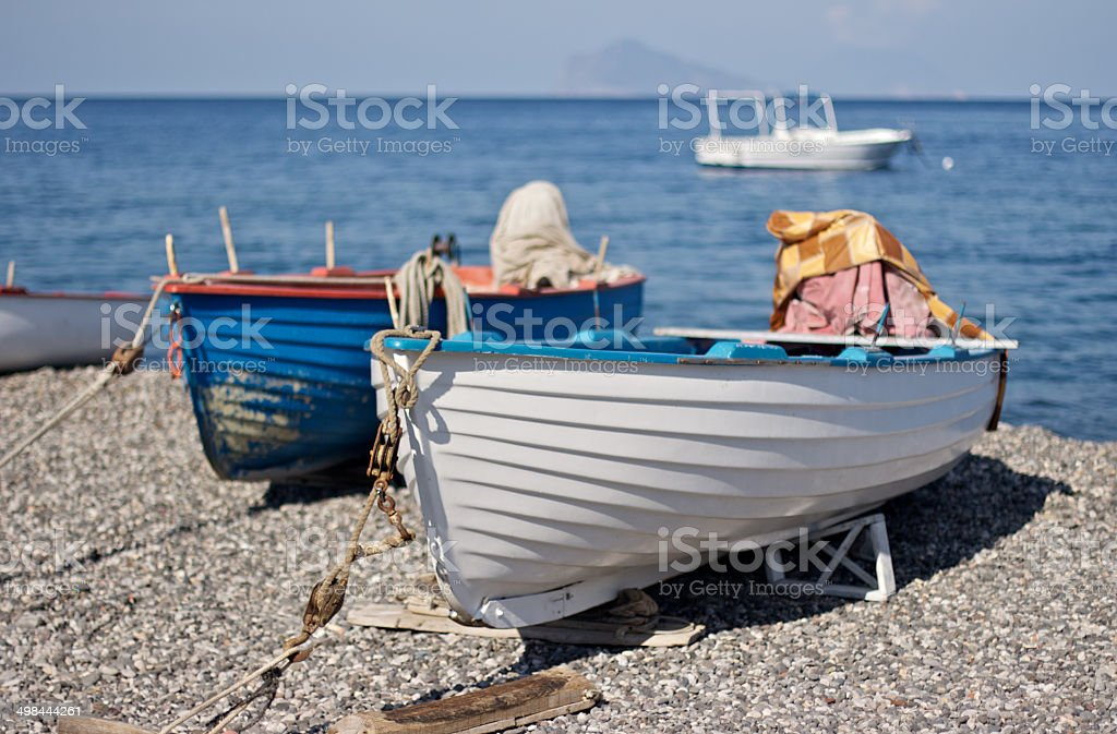 Small boat on the beach stock photo