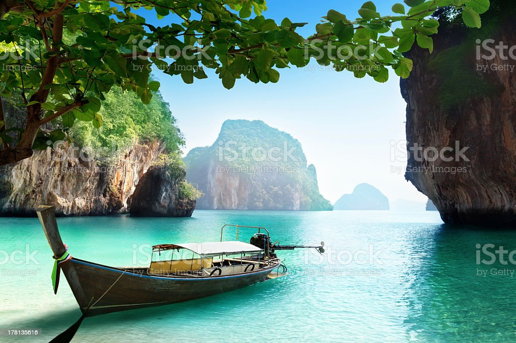 A small boat on the water in Thailand stock photo