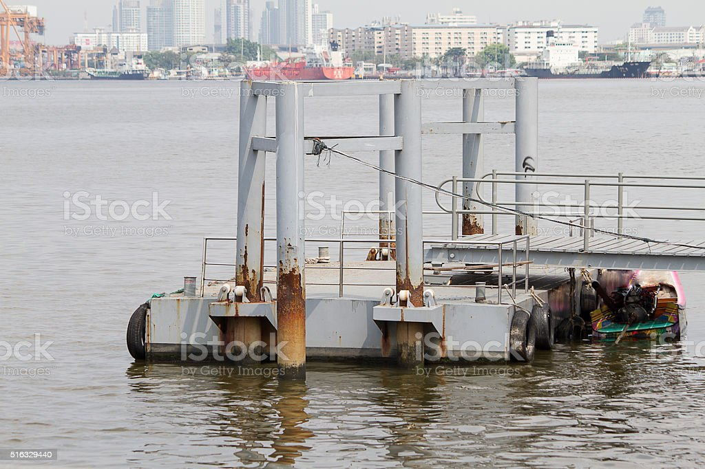 Small boat pier or pontoon on the river stock photo