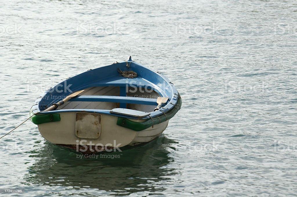 Small boat towards the sea royalty-free stock photo