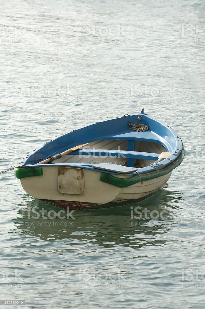 Small boat towards the sea, vertical royalty-free stock photo