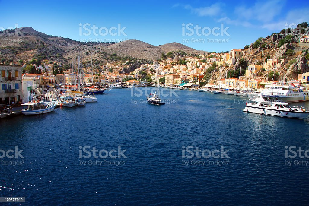 Small boats and houses on symi island, , Greece stock photo