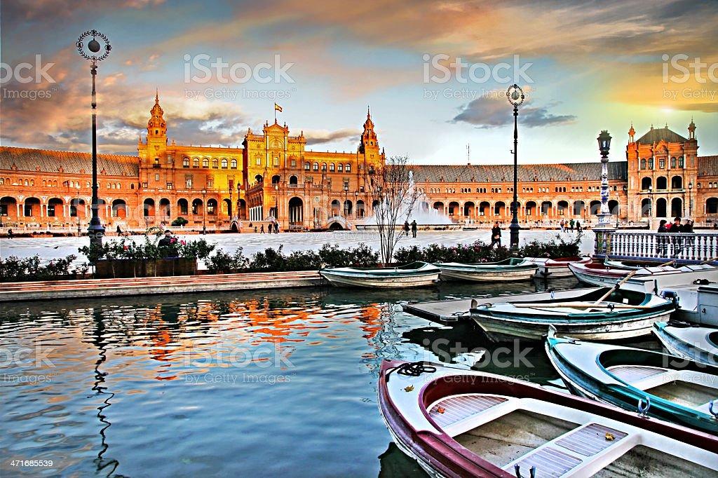 Small boats at river dock in sevilla royalty-free stock photo