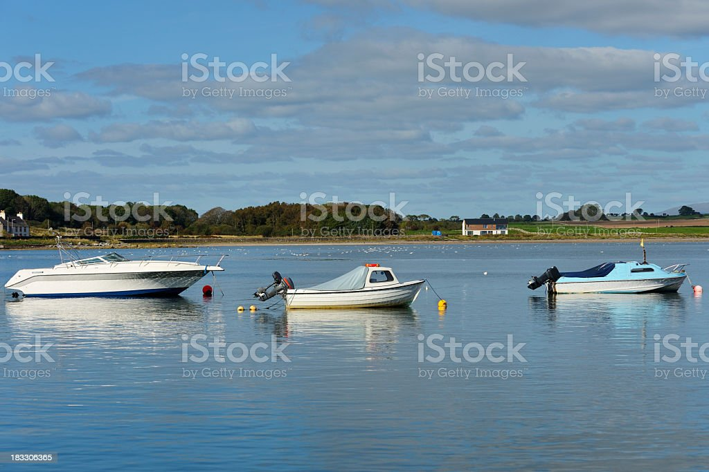 Small boats in a Scottish harbour in summer stock photo