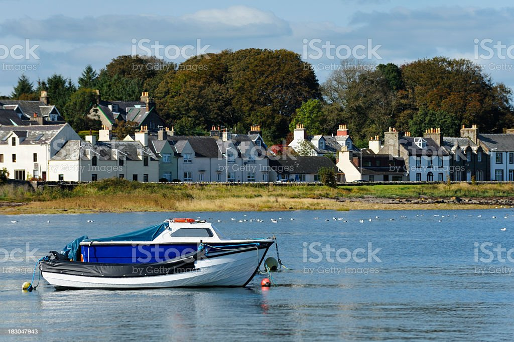 Small boats moored in a Scottish harbour stock photo