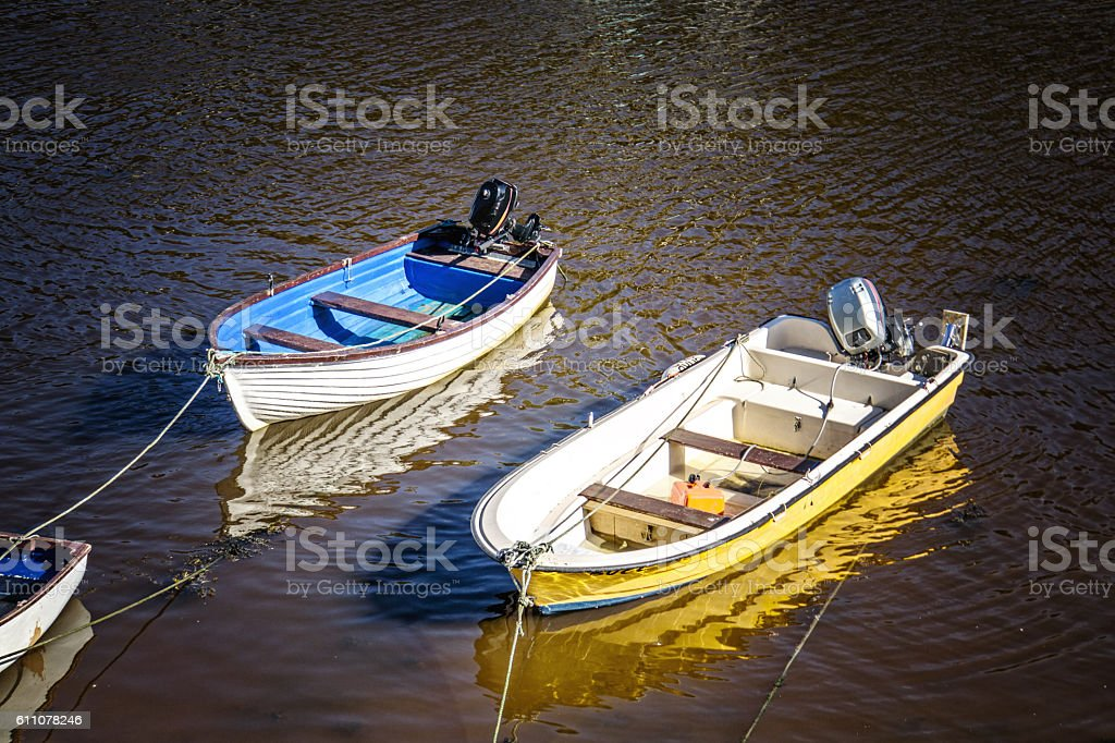 Small boats moored in Solva Harbour stock photo