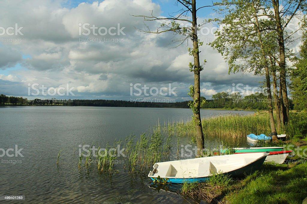 Small Boats on Shore of lake. Mazury. Poland royalty-free stock photo