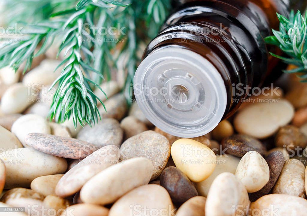 Small bottle of essential juniper oil. stock photo
