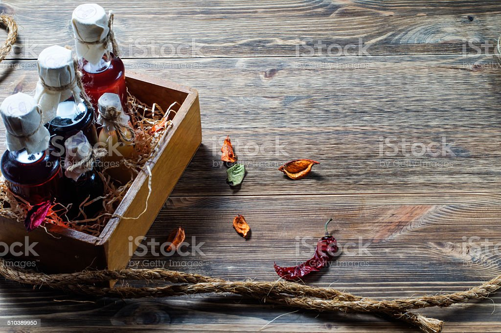 Small bottles of liquor in a wooden box stock photo