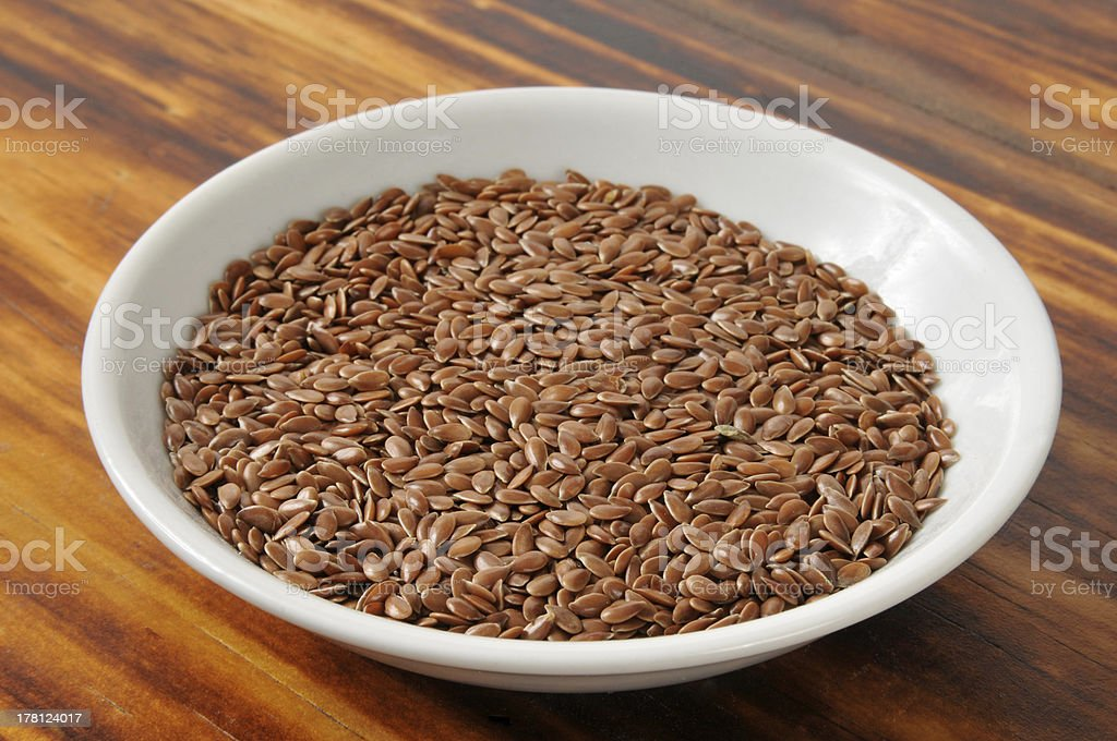 Small bowl of flaxseed royalty-free stock photo