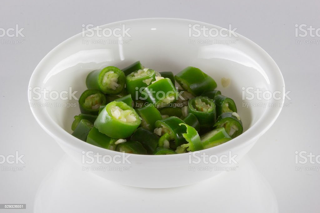 Small Bowl of Green Thai Chili Peppers stock photo