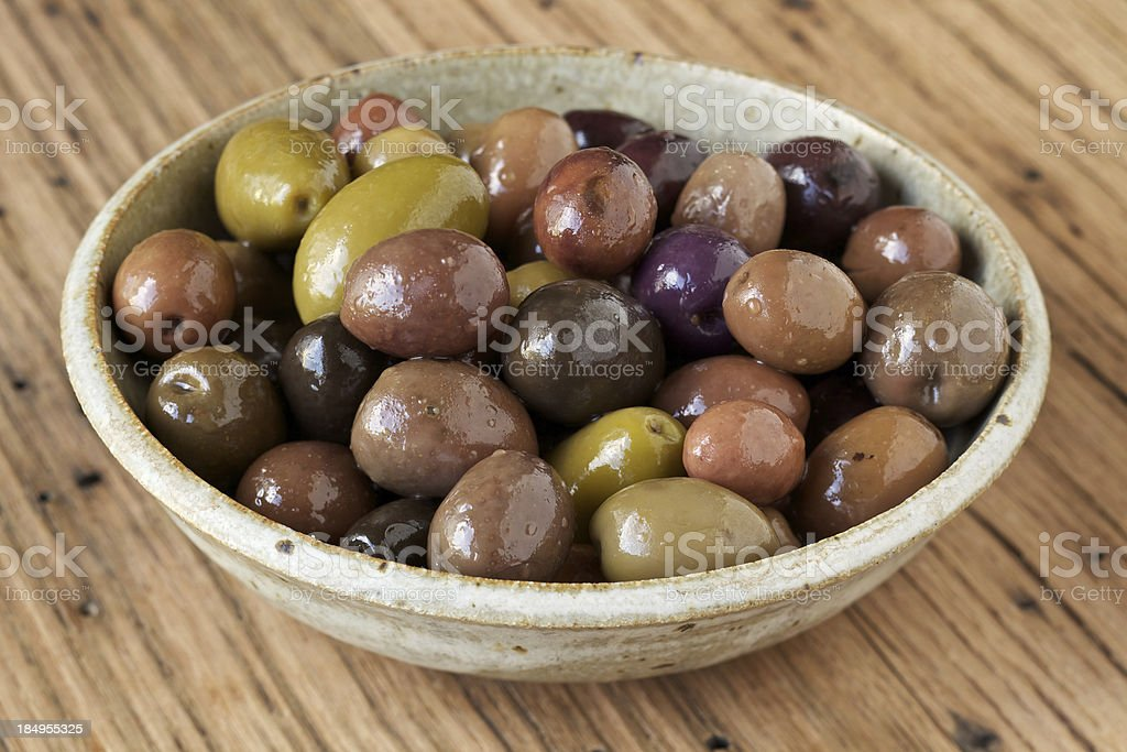 Small bowl of organic olives stock photo