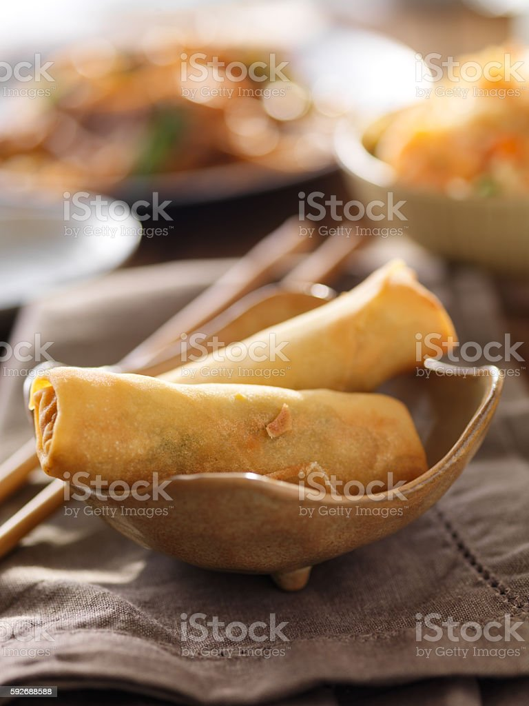 small bowl with two crispy egg rolls stock photo
