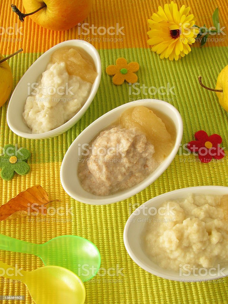 Small bowls with millet porridge, creamed rice and spelt mash stock photo