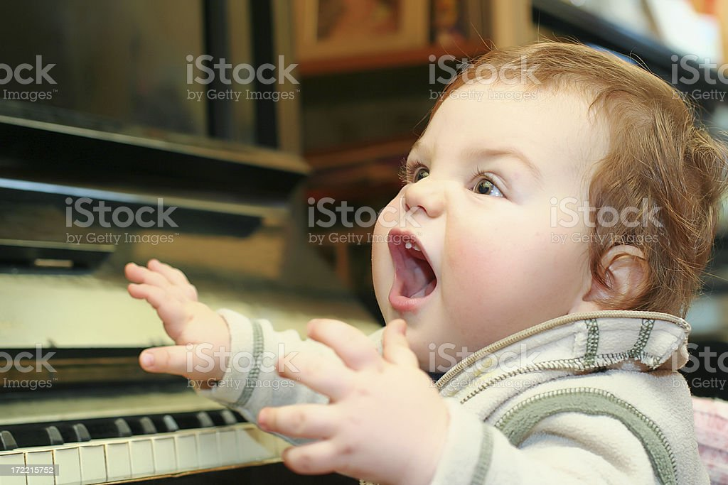 Small boy by the piano royalty-free stock photo