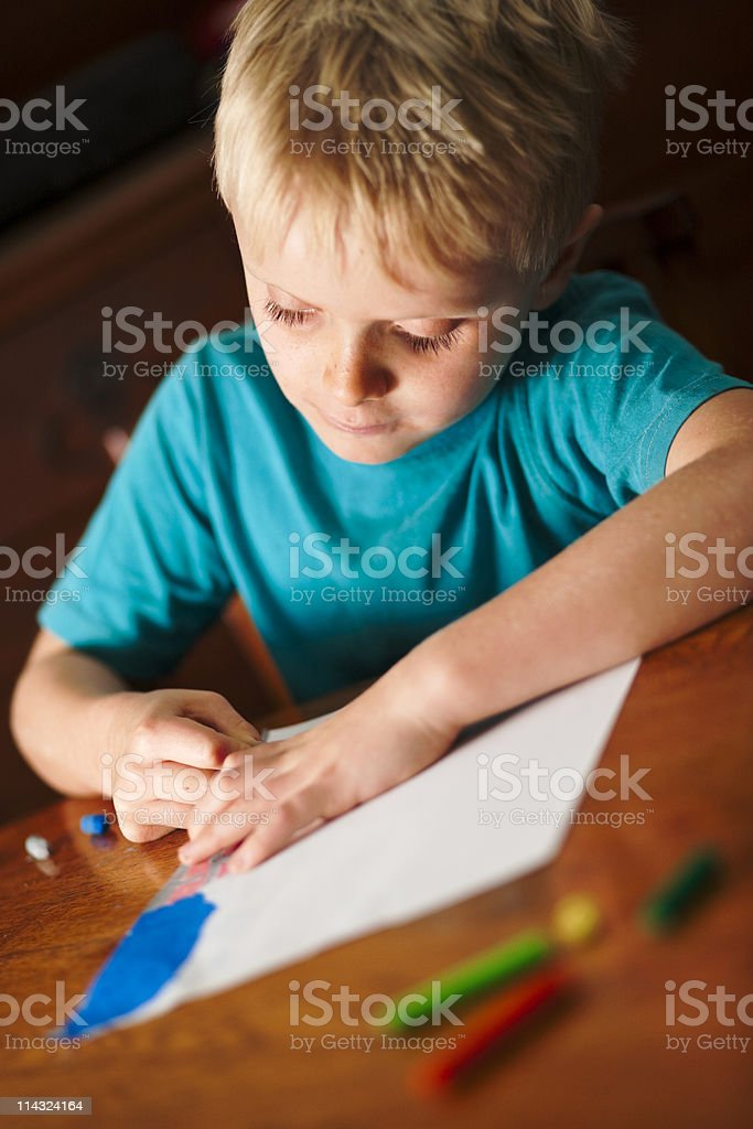Small boy drawing a picture royalty-free stock photo