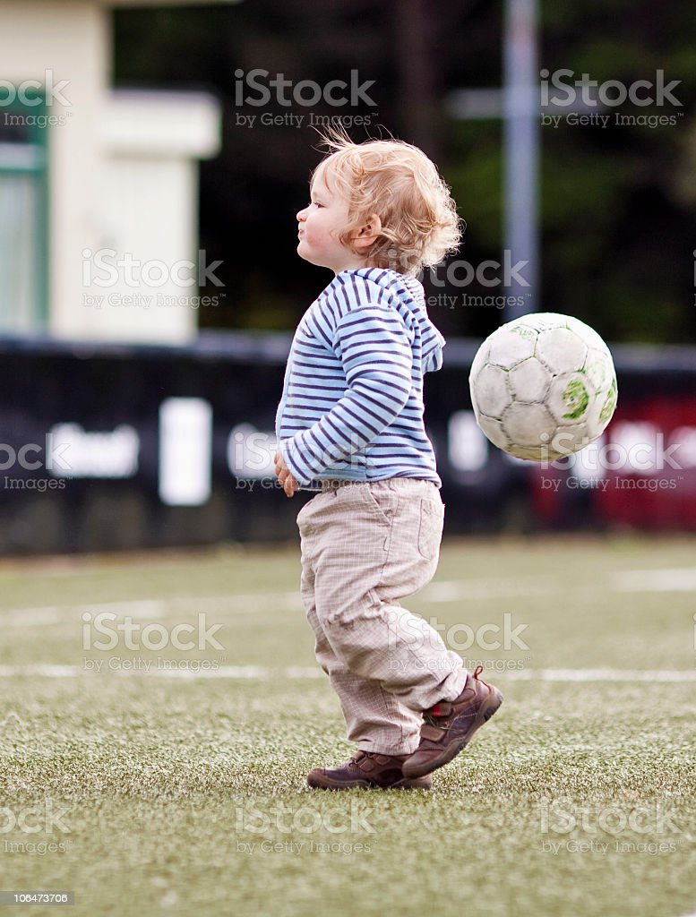 Small boy in football field stock photo