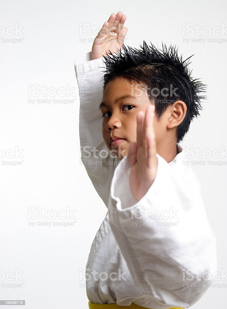 Small boy in karate outfit and stance stock photo