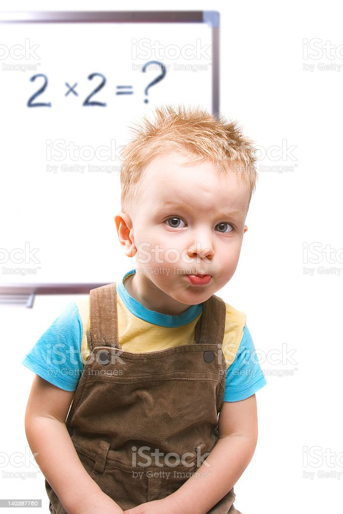 Small boy is looking for solution of challenging task royalty-free stock photo