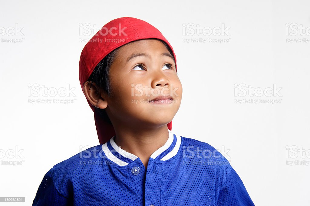 Small boy looking up stock photo