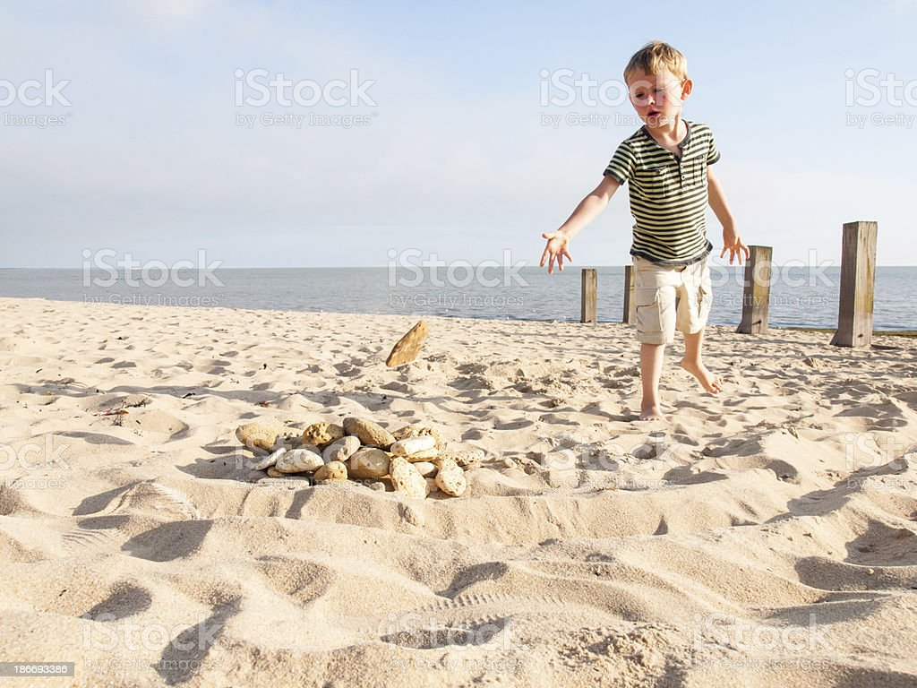 small boy on a beach stock photo