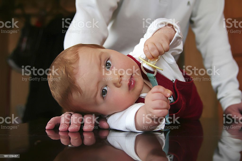 Small boy on a table royalty-free stock photo