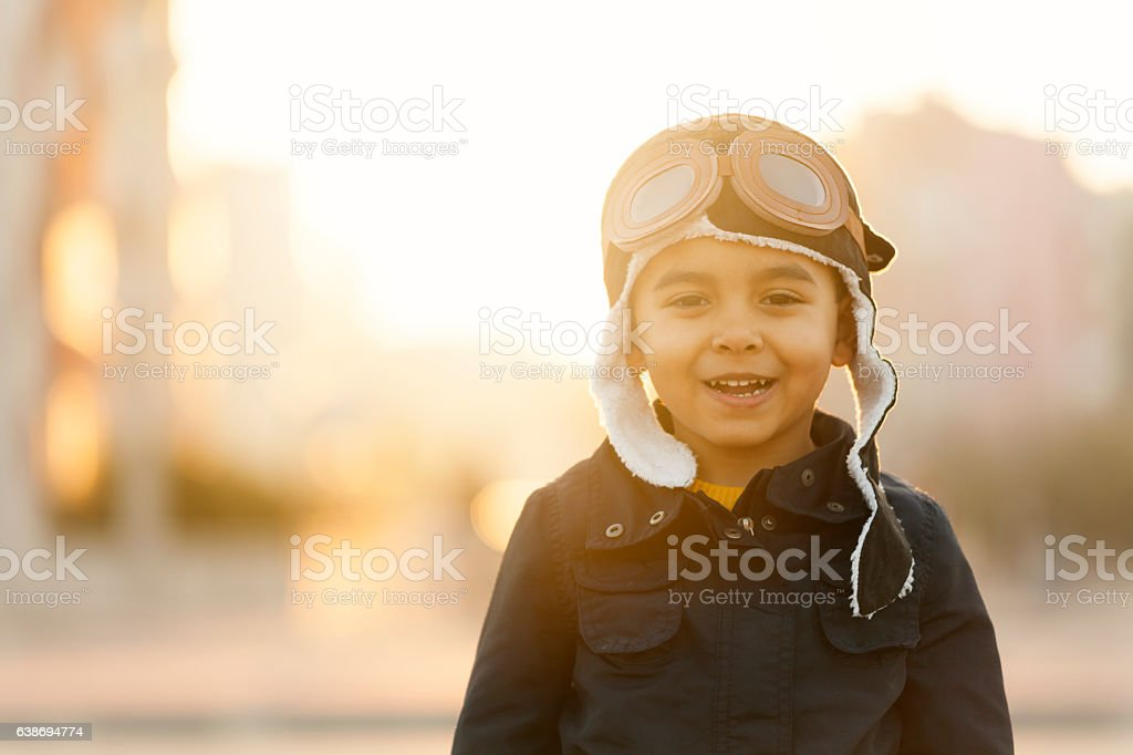 Small boy playing with paper plane stock photo