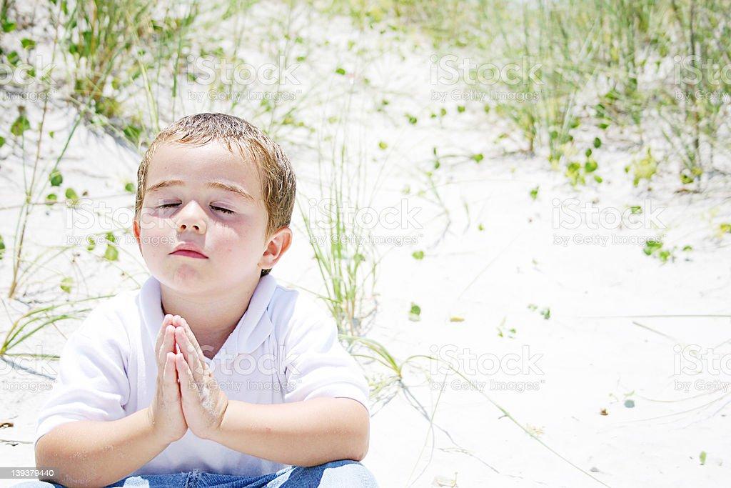 small boy praying royalty-free stock photo