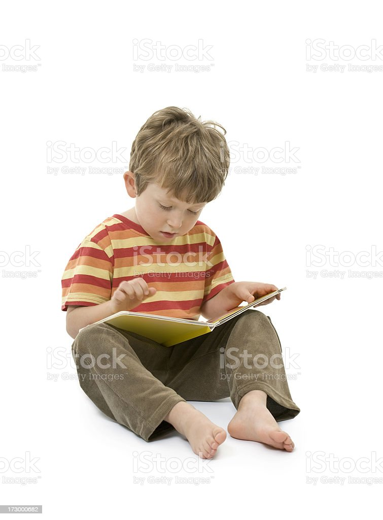 small boy reading a book royalty-free stock photo