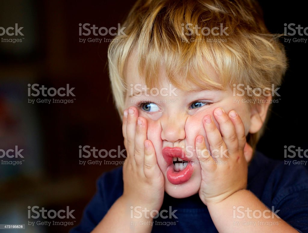 Small boy says 'oh, no!' stock photo