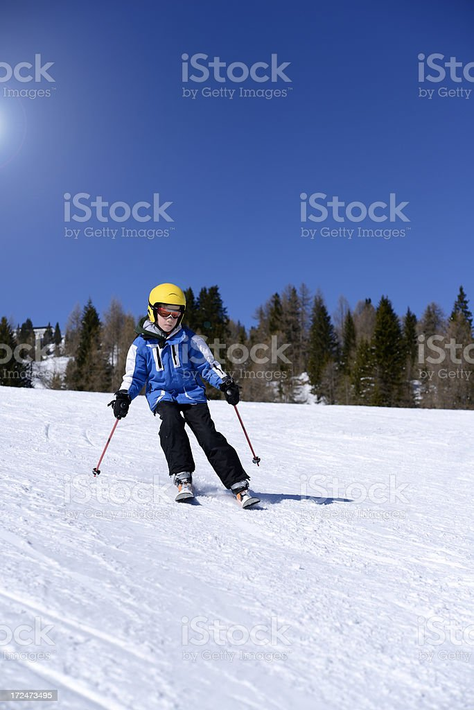 Small Boy Skiing stock photo