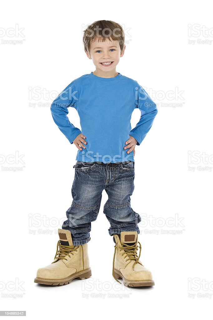 Small boy wearing big boots on white background royalty-free stock photo