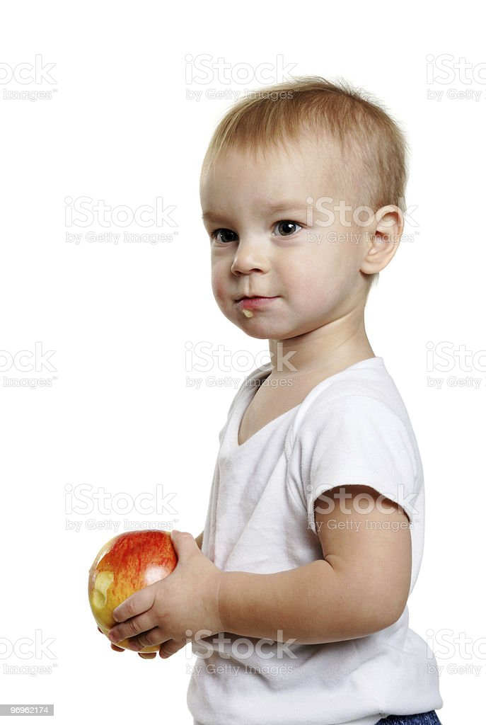 small boy with a red apple stock photo
