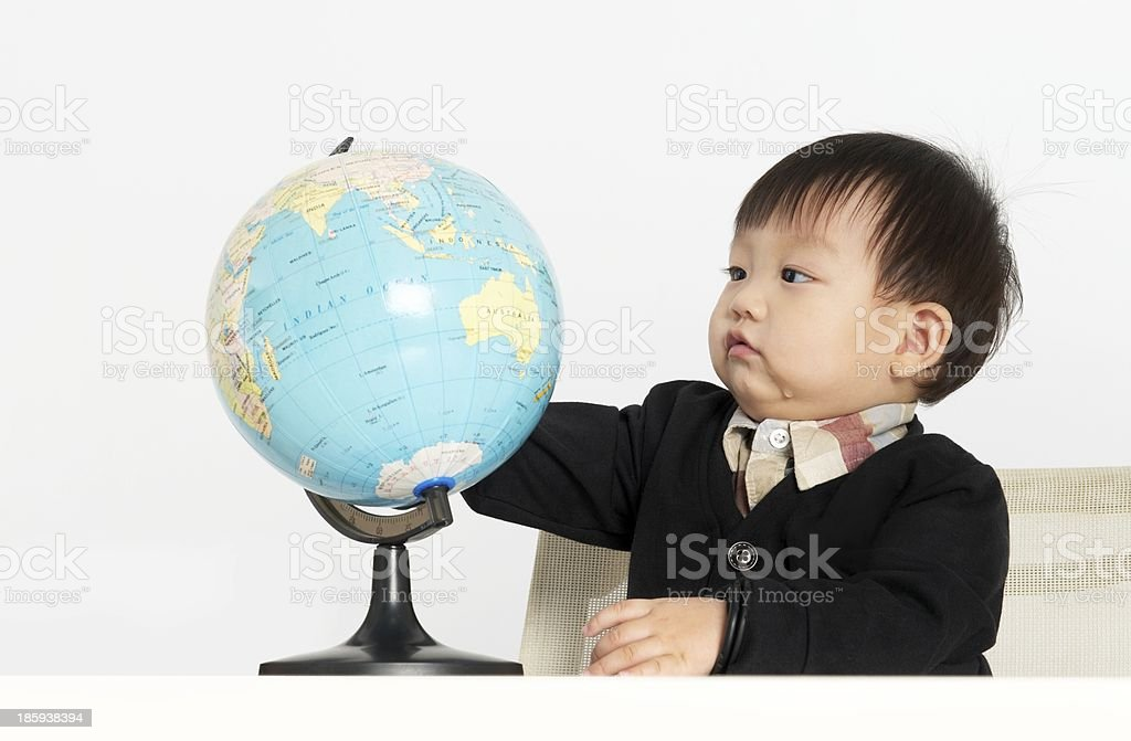 Small boy with globe stock photo