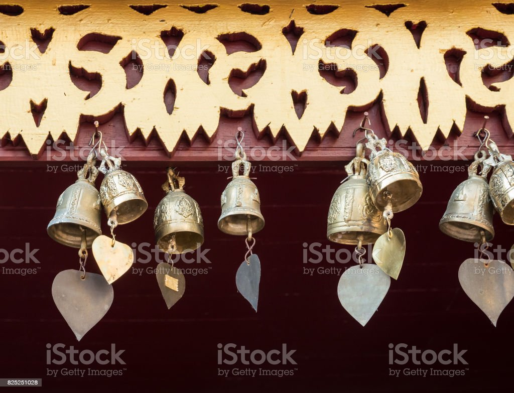 Small brass bell with the heart shape tail. stock photo