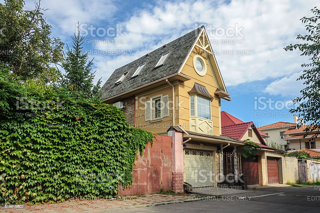 Small brick two-storied residential house stock photo