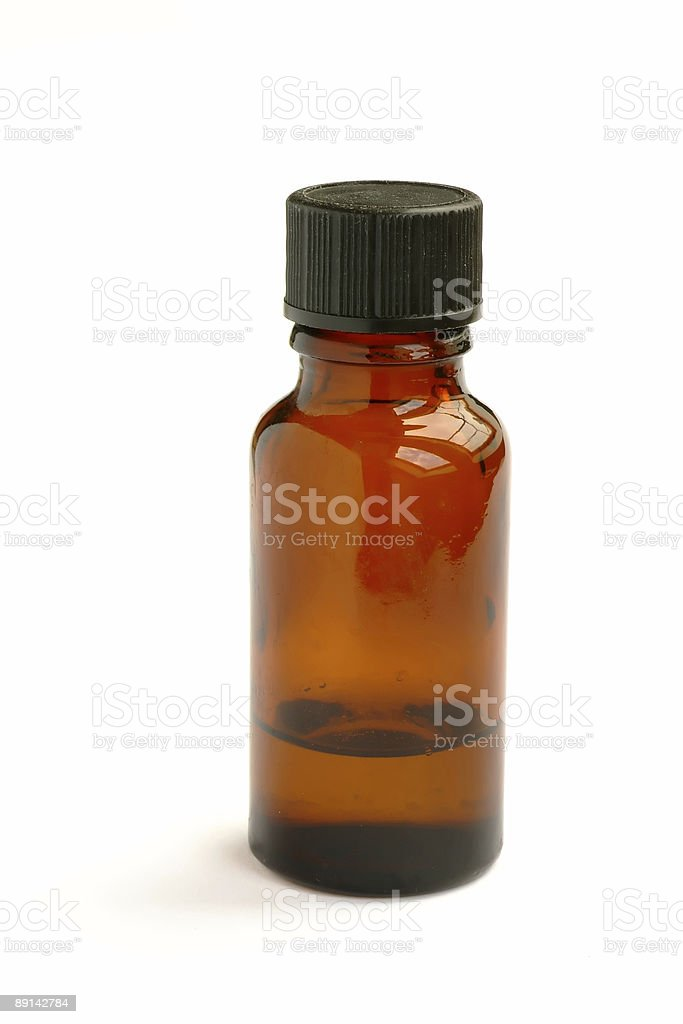 Small brown bottle isolated on white stock photo