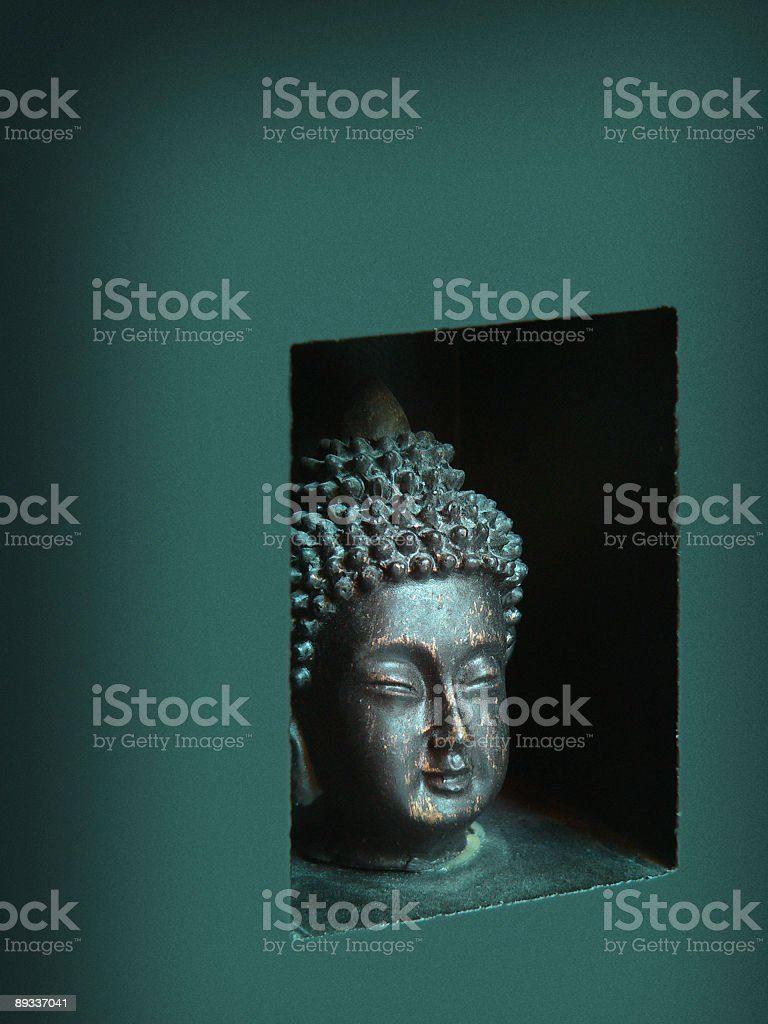 Small Buddha statue head with green tone and nice finish stock photo