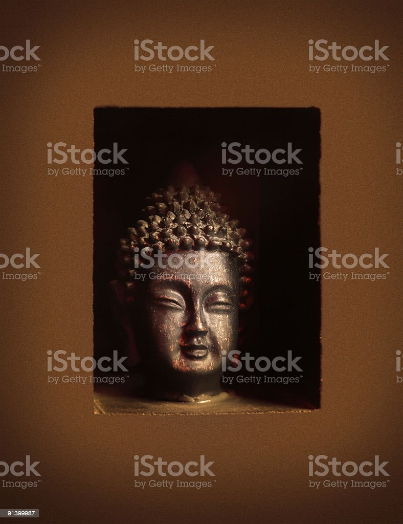 Small Buddha statue head with sepia tone and nice finish stock photo