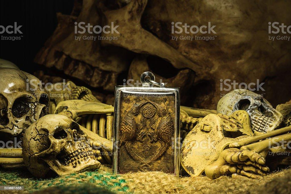 small buddha with human skull still life background stock photo