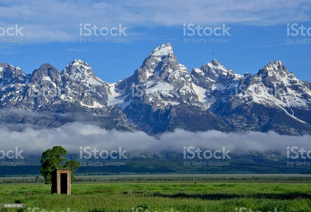 Small Building with Tetons in the background stock photo